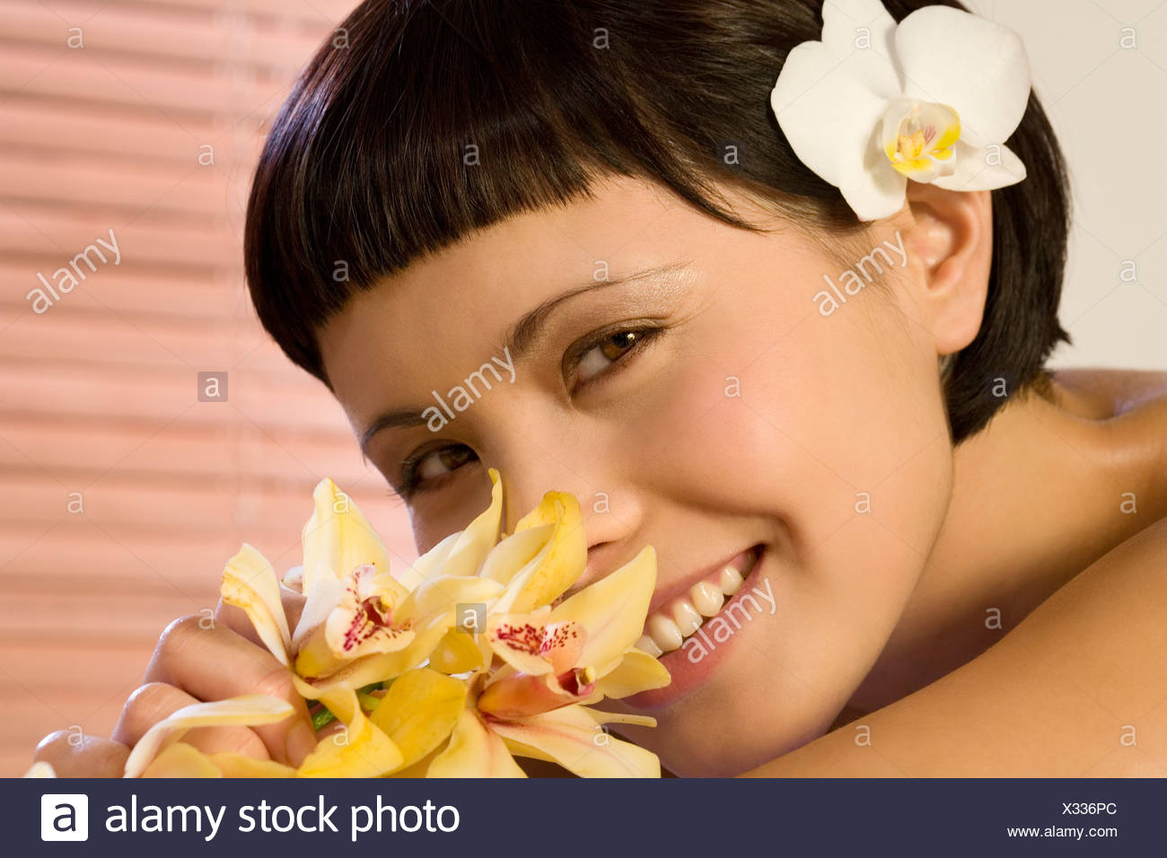 Young woman relaxing in spa, portrait, close-up - Stock Image