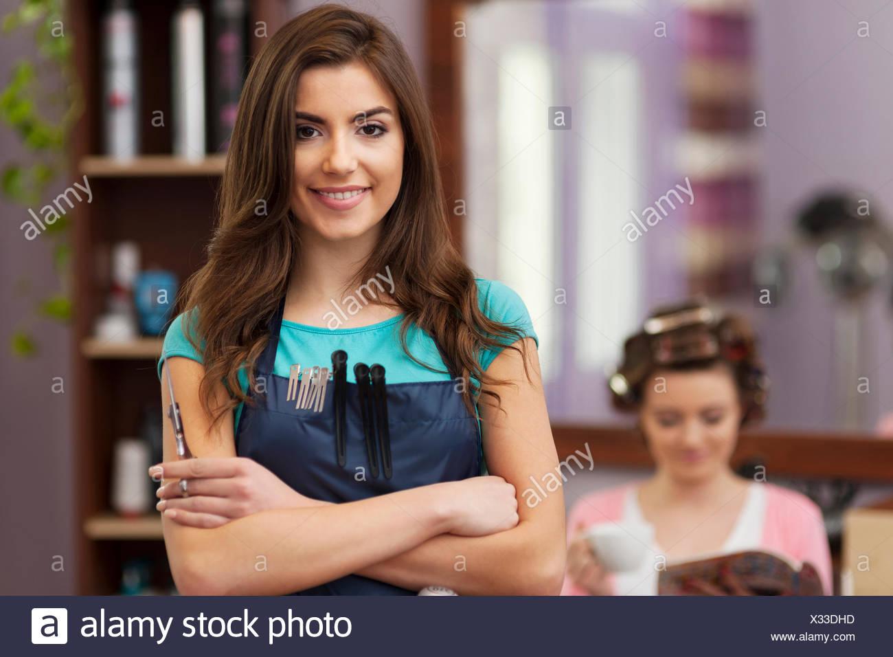 Portrait of smiling owner of hairdresser salon. Debica, Poland - Stock Image