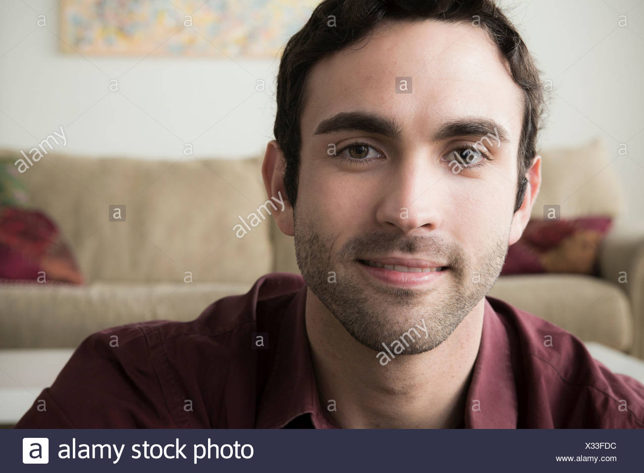 Portrait of young man with black hair - Stock Image