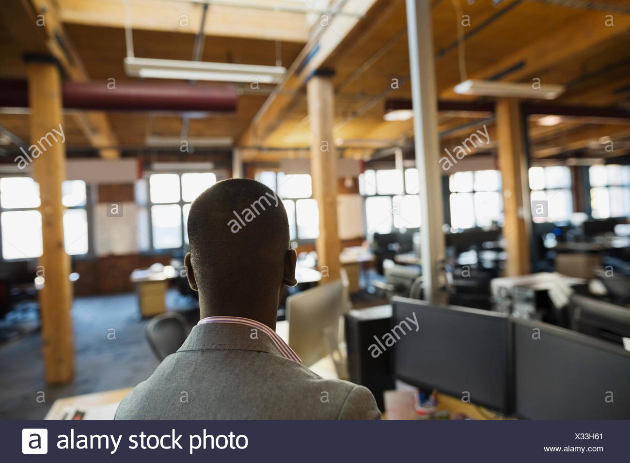 Businessman in open office - Stock Image