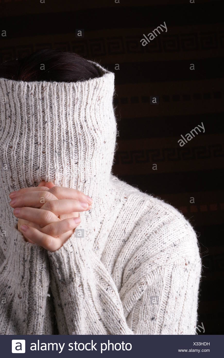 humor,bizarre,hiding,turtleneck,praying - Stock Image