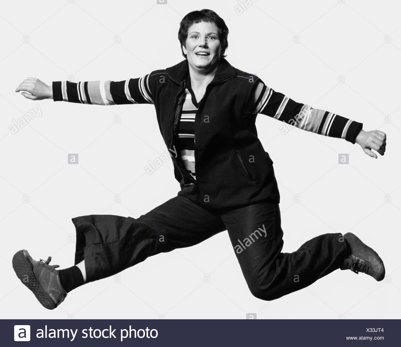 A lady in awkward pose - Stock Image