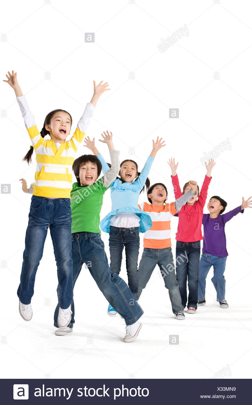 A group of children jumping up with excitement Stock Photo
