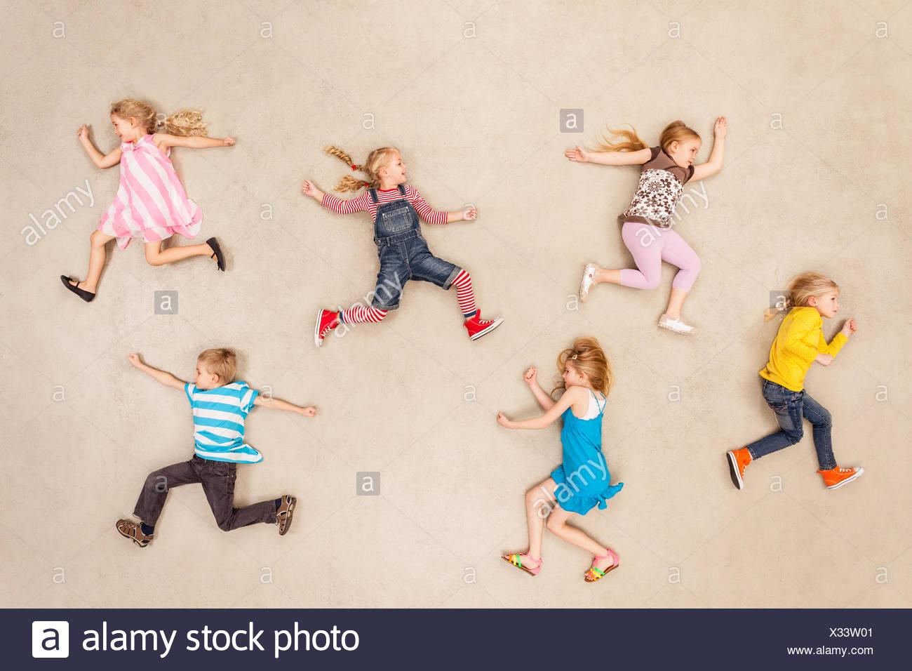 Children running around in chaos - Stock Image