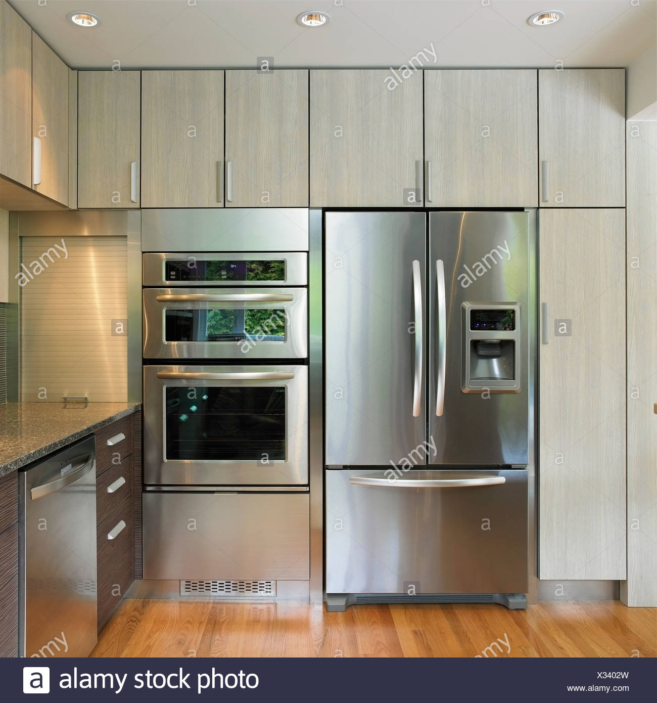 Kitchen Wall Featuring Built-In Fridge And Wall Oven ...