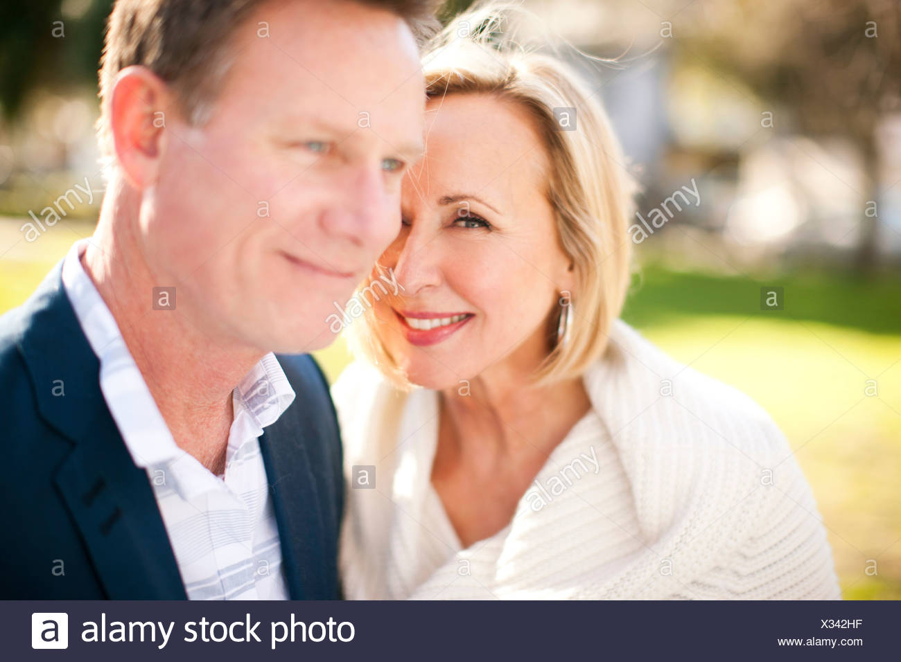 Loving heterosexual couple in park - Stock Image