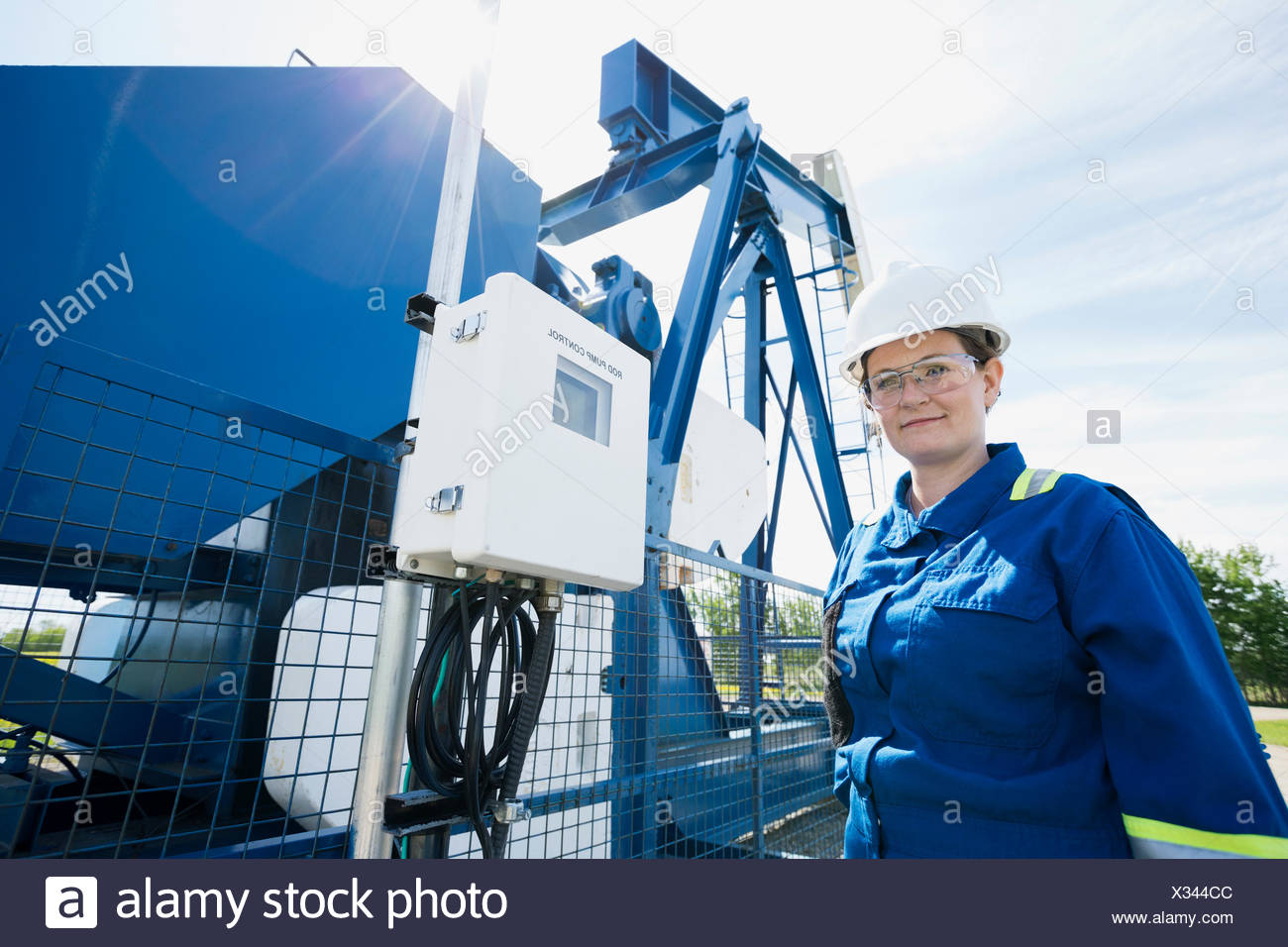 Female worker at oil well - Stock Image