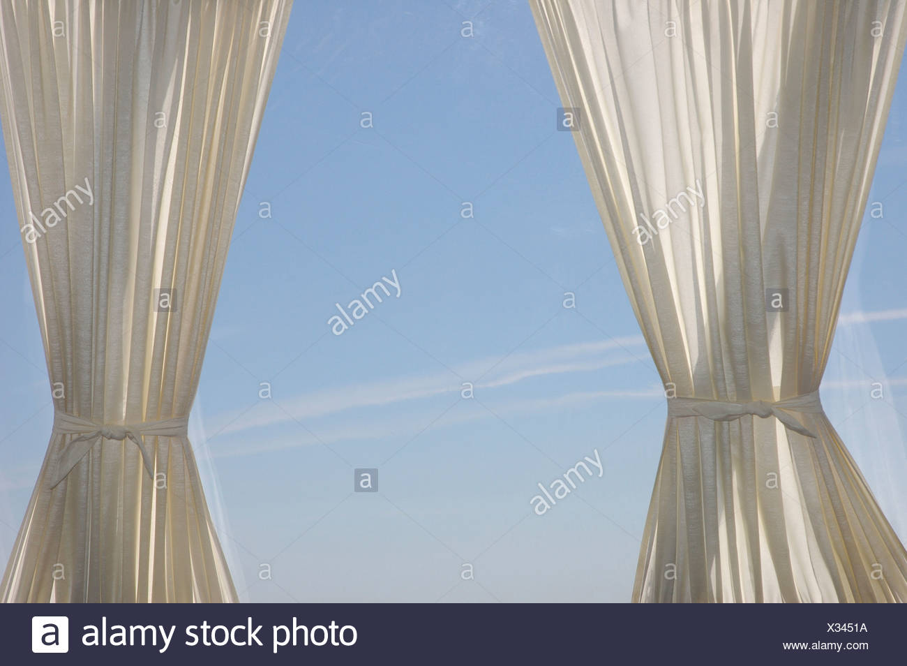 Two Elegant White Curtains Are Seen Against A Glass Window Stock Photo Alamy