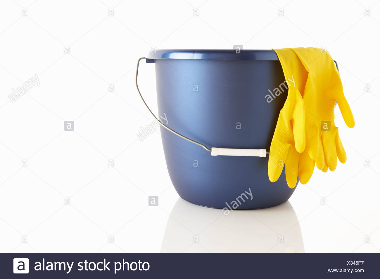 Bucket and rubber gloves Stock Photo