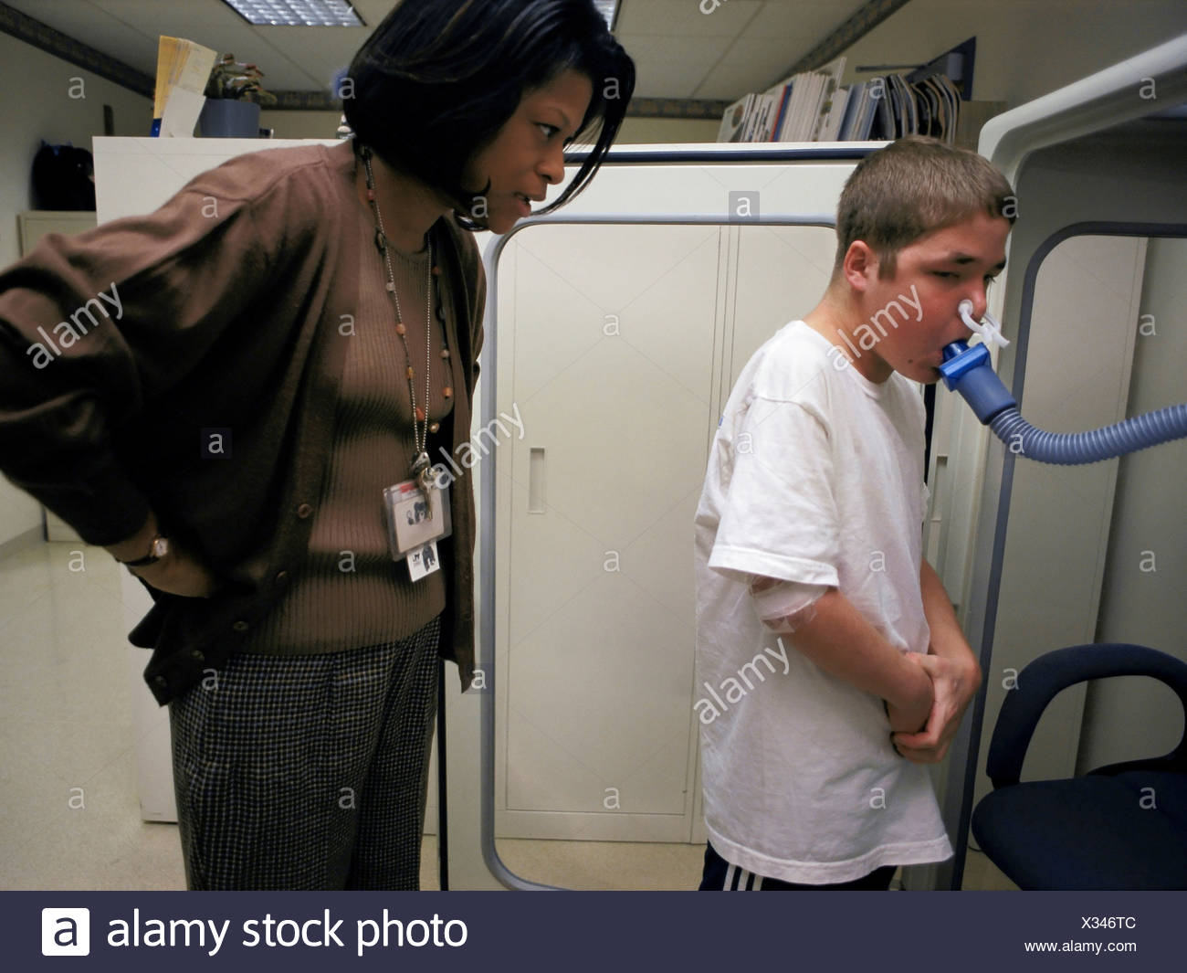 Boy with Cystic Fibrosis Taking a Lung Capacity Test - Stock Image