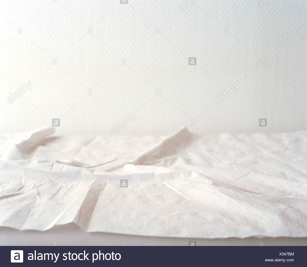 Crumpled sheets on hospital bed - Stock Image