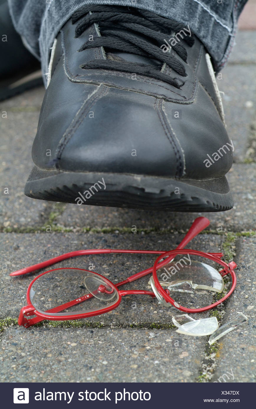 boy steps on eyeglasses Stock Photo