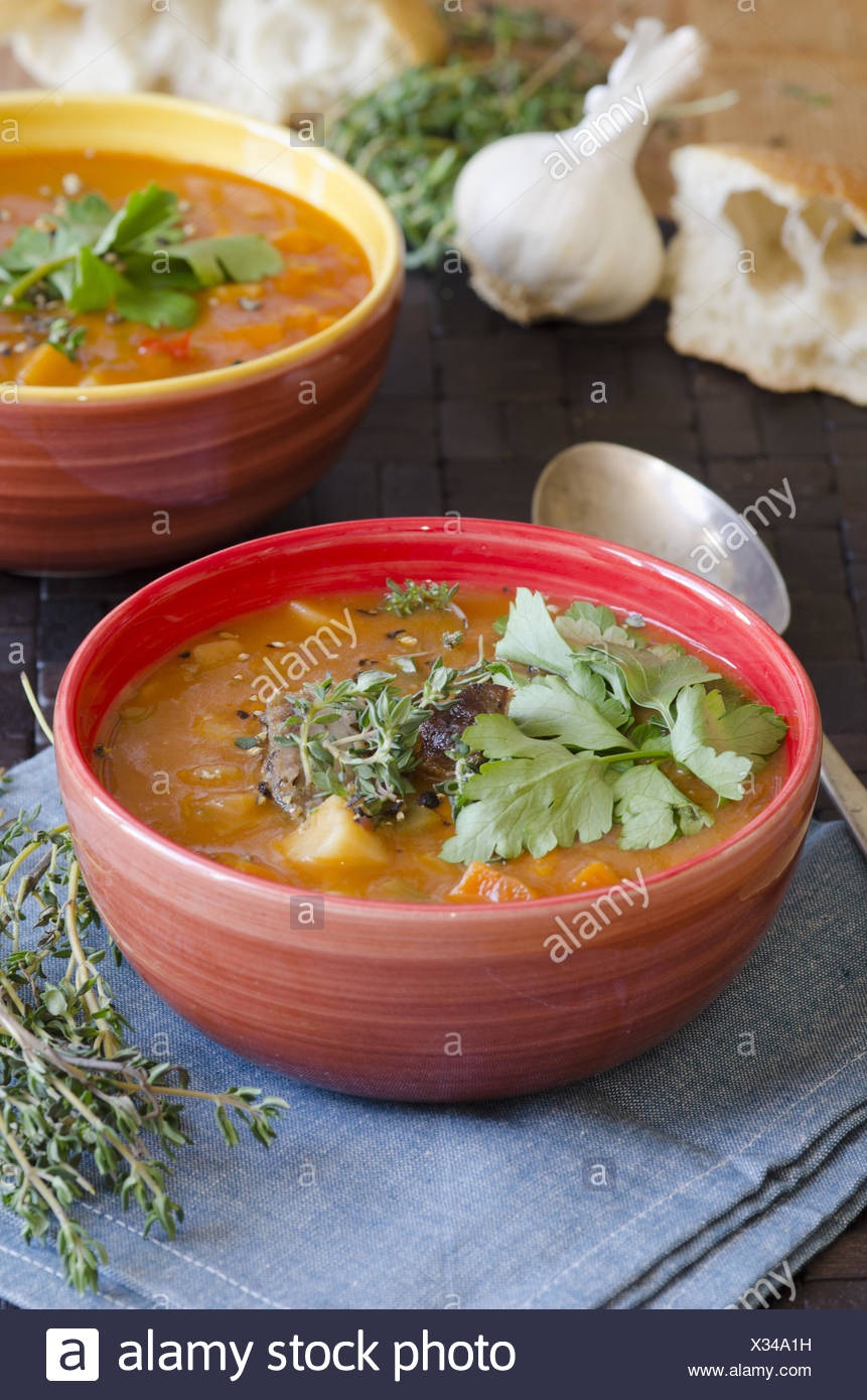 Slow-cooked lamb and root vegetable soup. - Stock Image