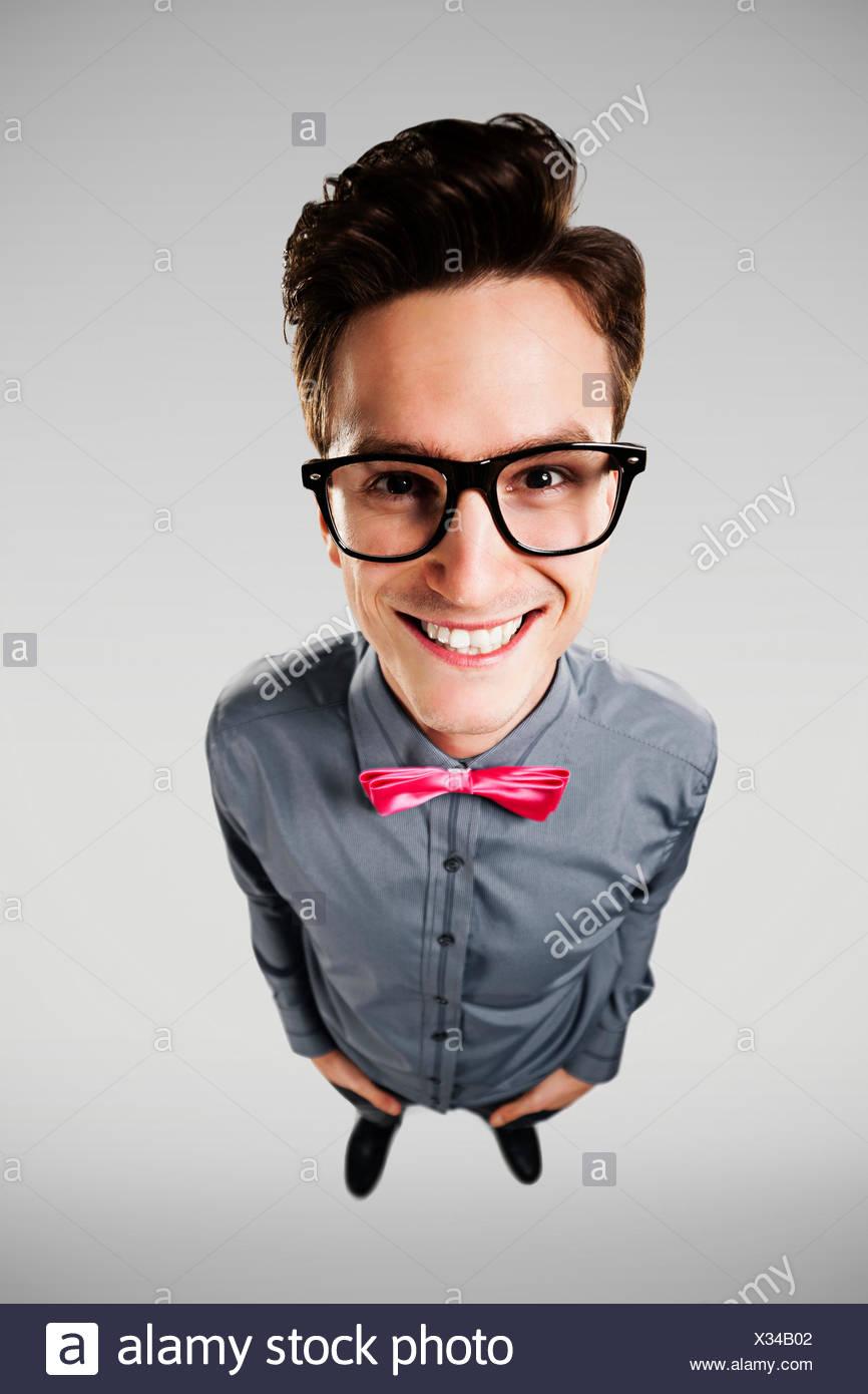 Portrait of smiling nerd Debica, Poland - Stock Image