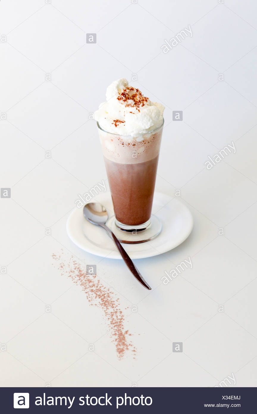 Hot Chocolate milk topped with whipped cream on white background - Stock Image