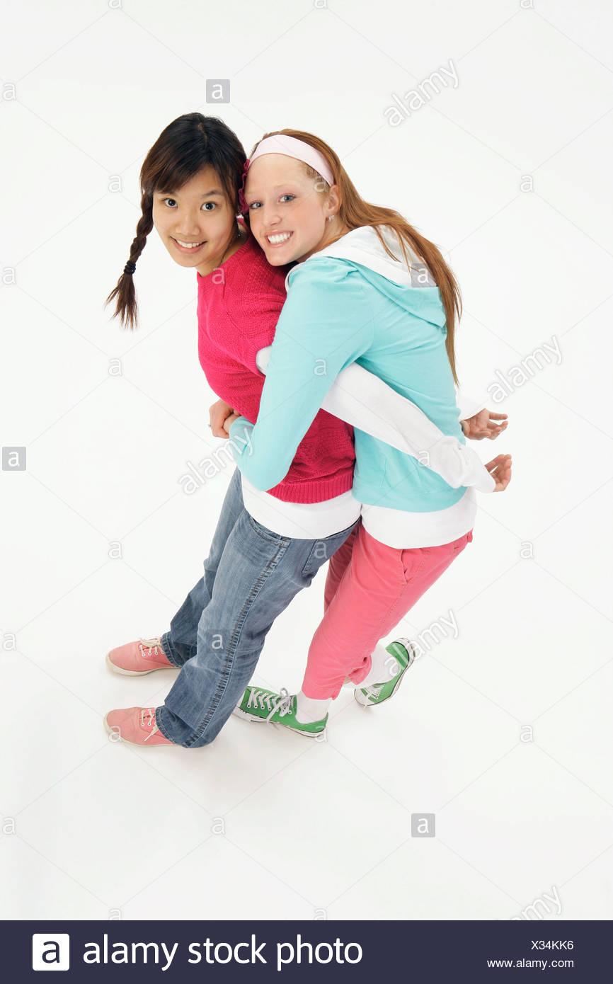 Teenagers hugging - Stock Image
