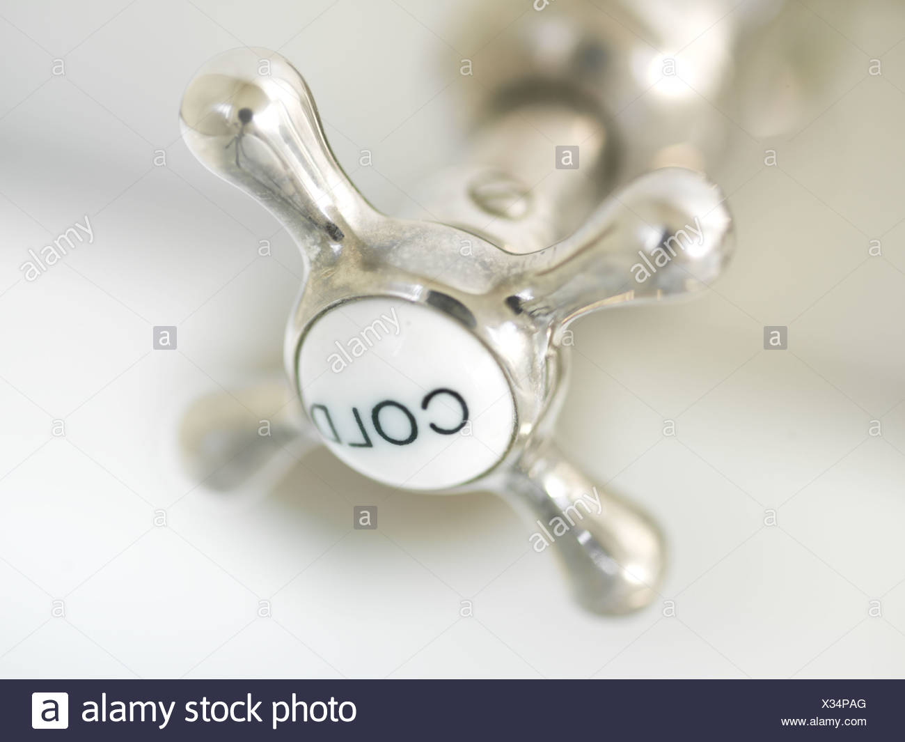 The top of a tap marked 'cold' - Stock Image