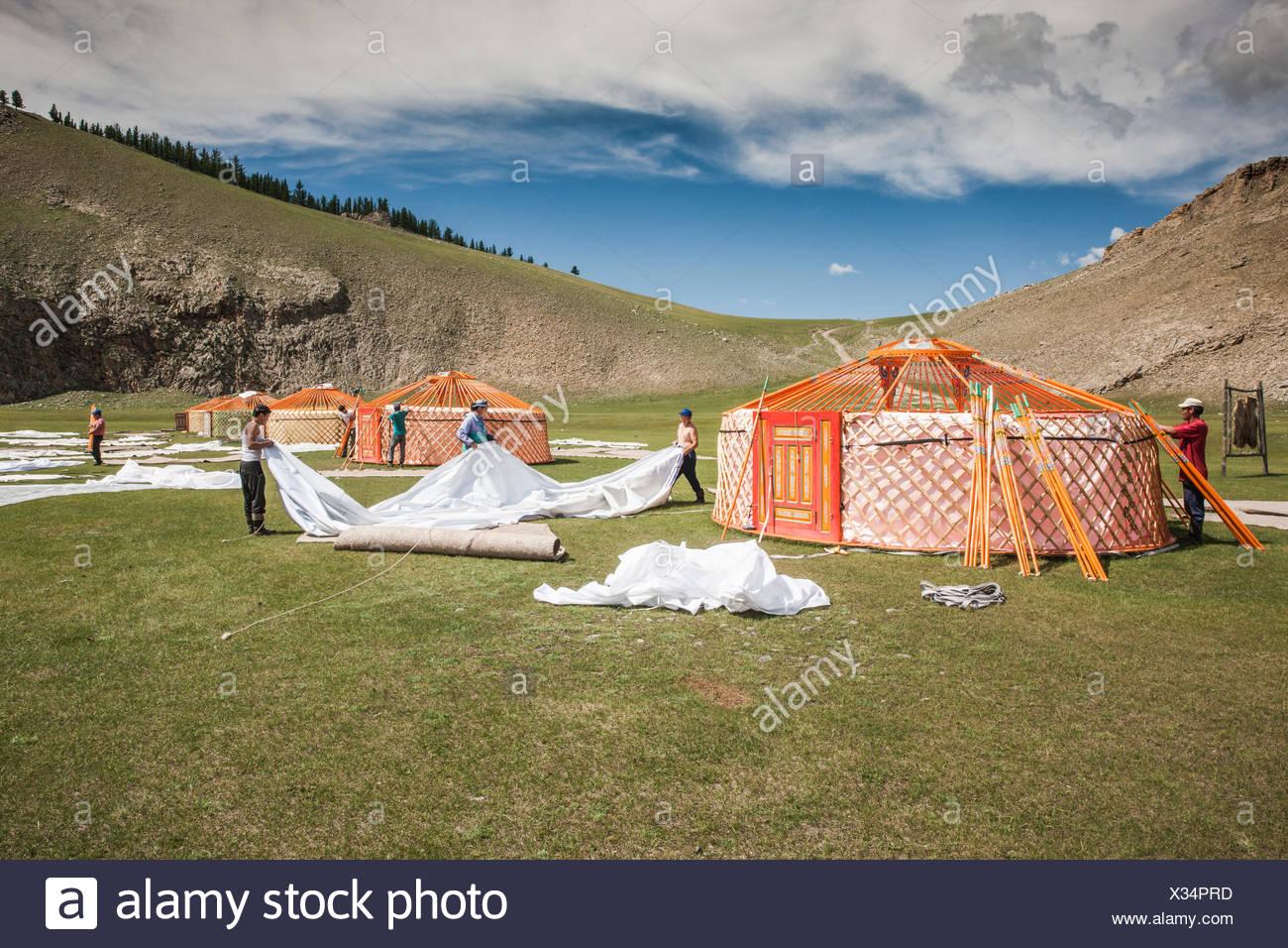 Mongol people at Lapis Sky Camp dismantling ger (yurt) camp at end of Summer Trip of 2017, Bunkhan, Bulgan, Mongolia - Stock Image