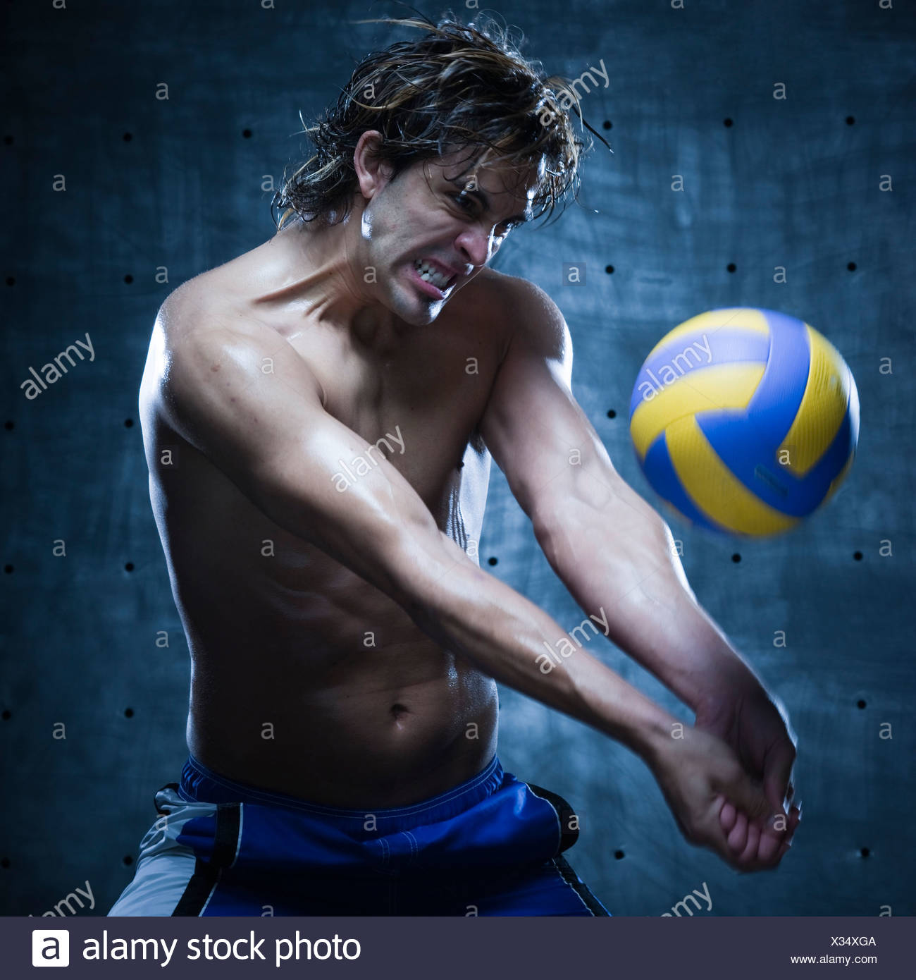 Studio shot of volleyball player playing - Stock Image