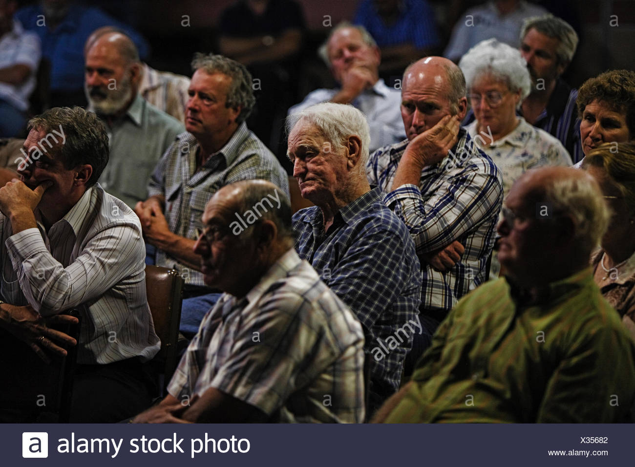 Rice farmers discuss water issues at a meeting. - Stock Image