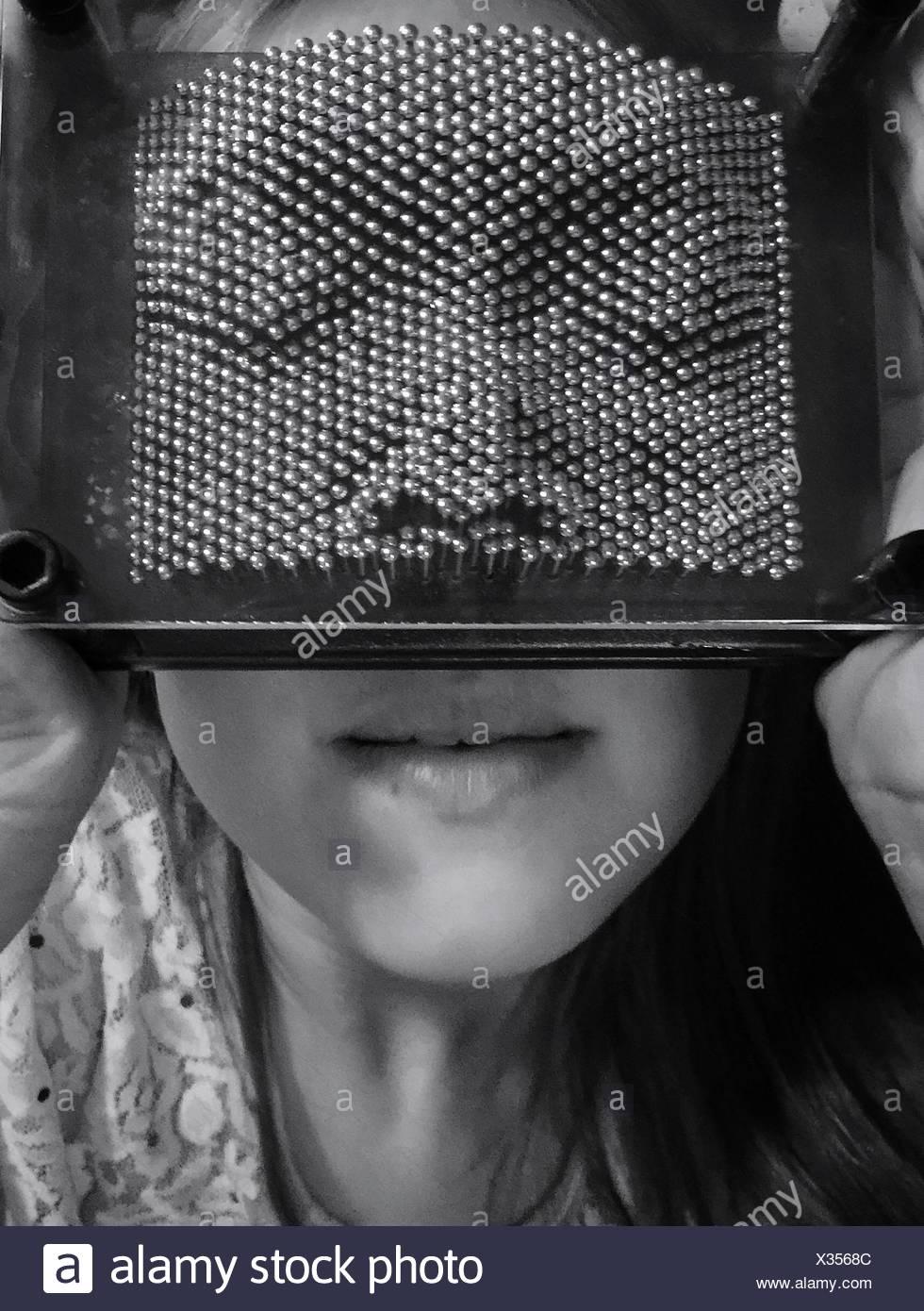 Close-Up Of Woman Wearing Pinhead - Stock Image