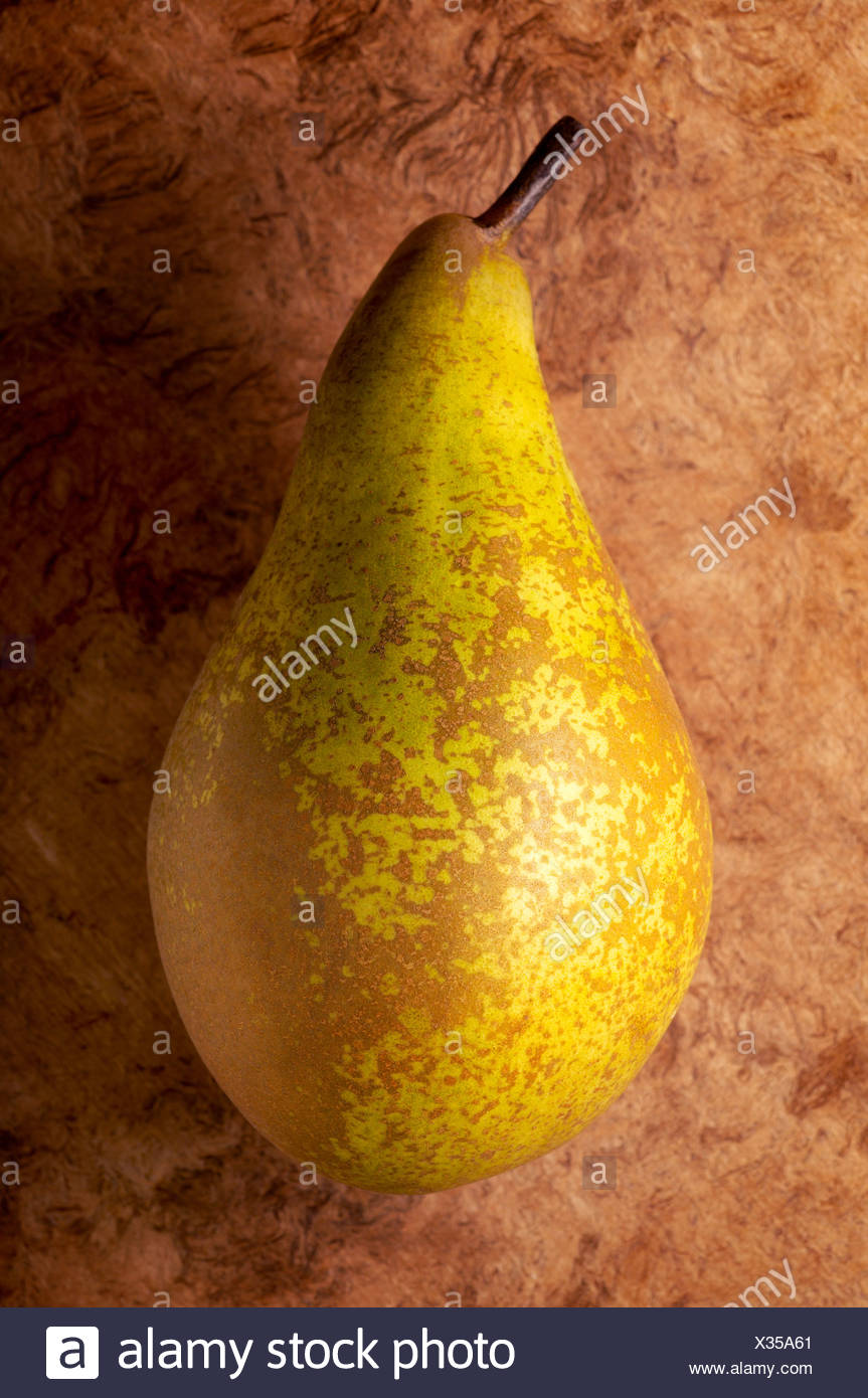 Pear on textured background - Stock Image