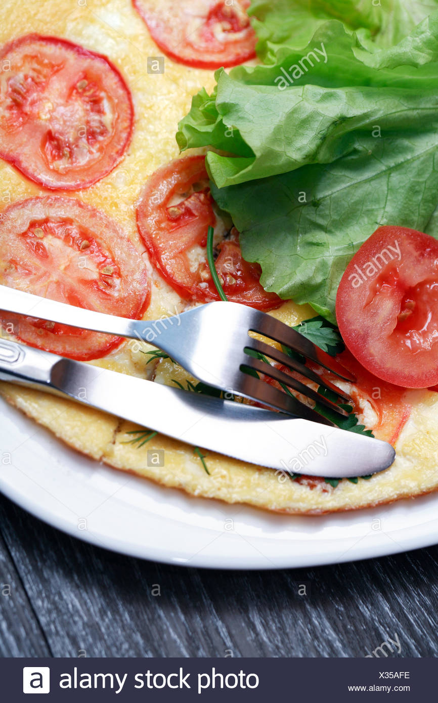 Omelet With Tomatoes - Stock Image