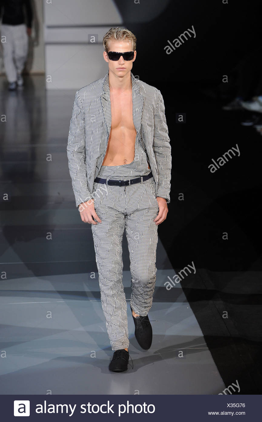 7ed47109dae6 Emporio Armani Milan Ready to Wear Spring Summer Model wearing black and  white checked trousers,