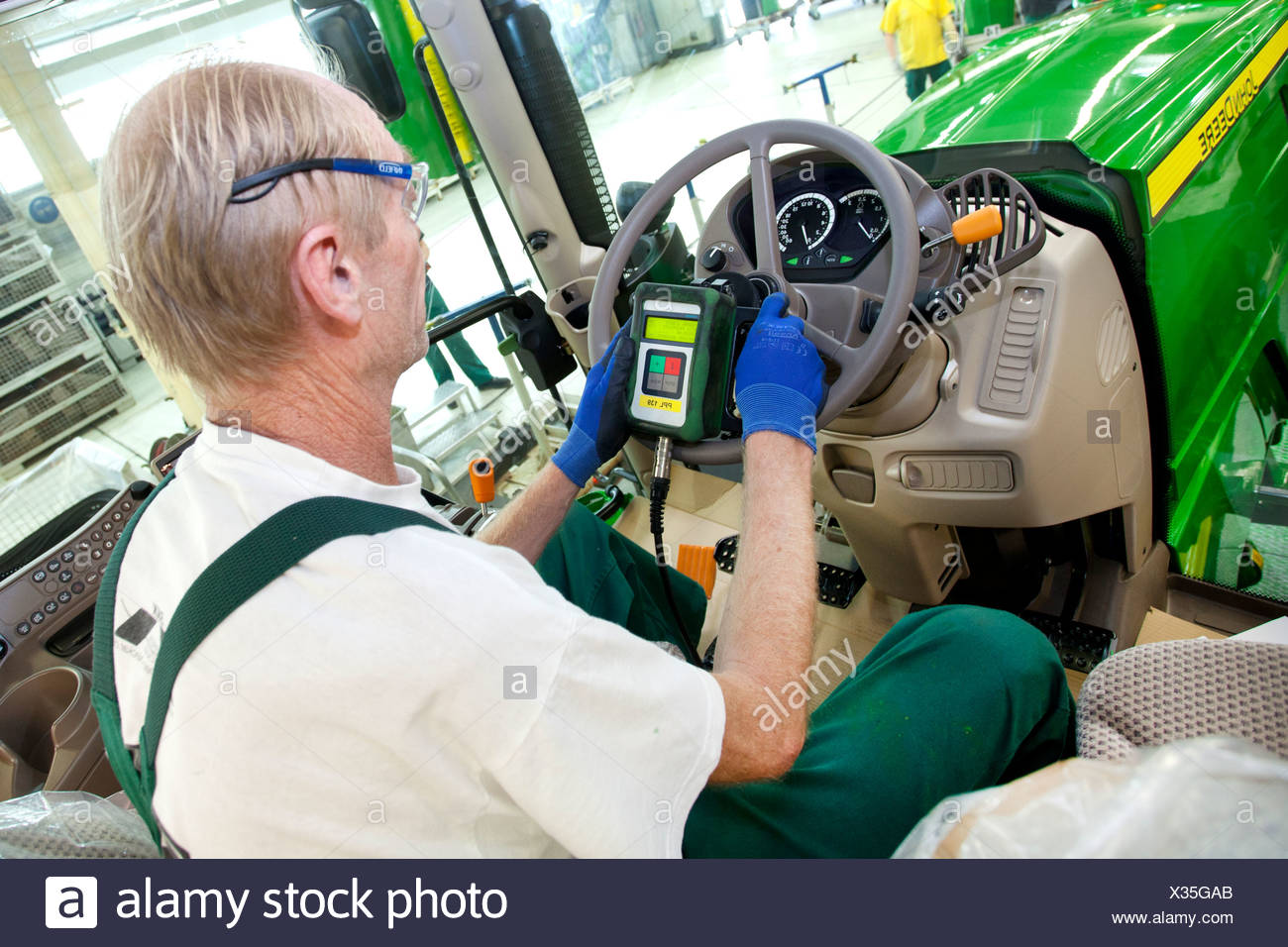 Electronic final check in the tractor production section at the European headquarters of the American agricultural machinery - Stock Image