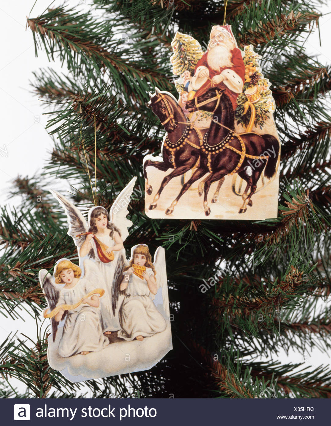 close up of victorian paper christmas tree decorations