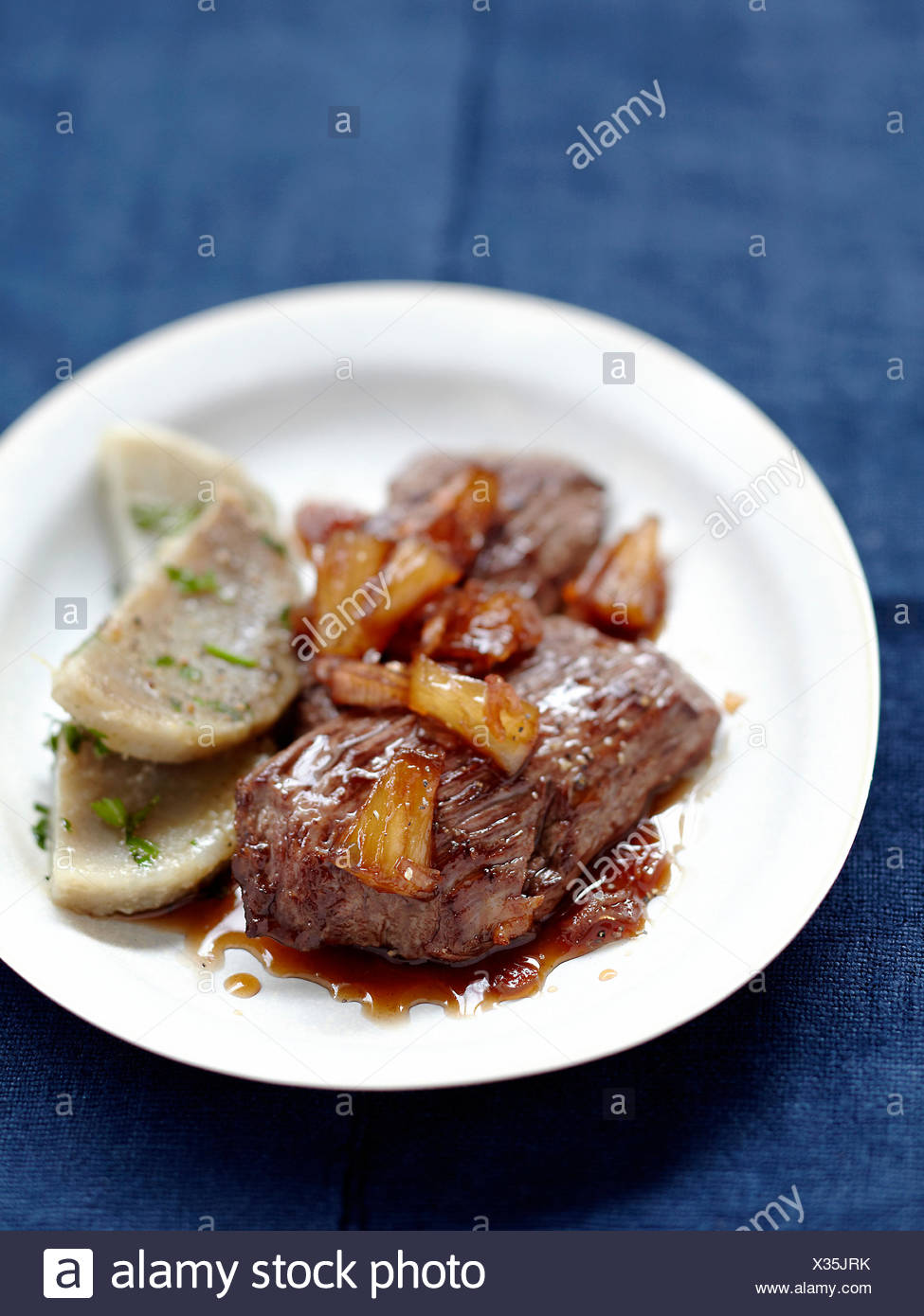 Sweet and salty grilled sirloin steak,artichoke bases with parsley - Stock Image