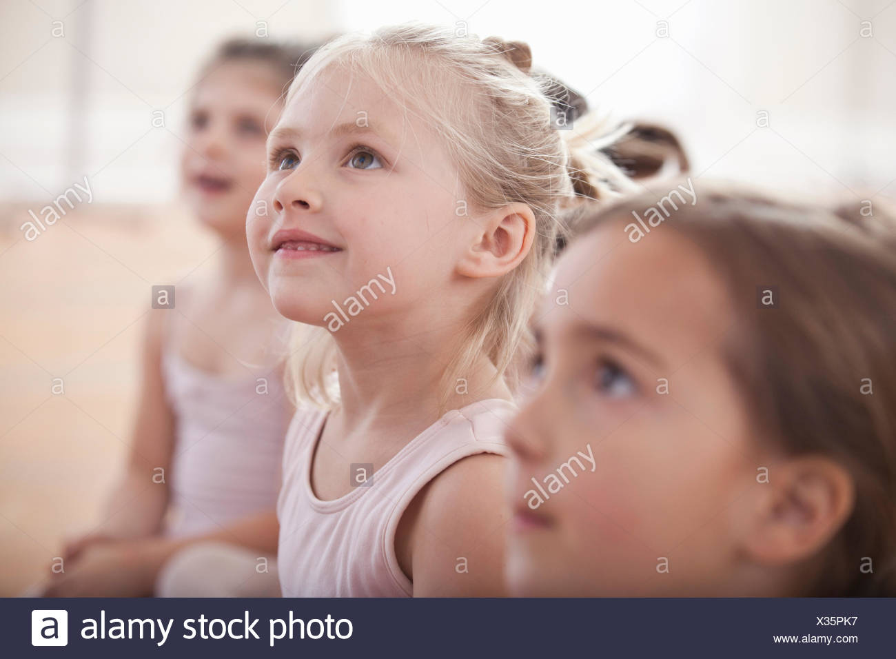 Group of girls looking up in ballet school Stock Photo