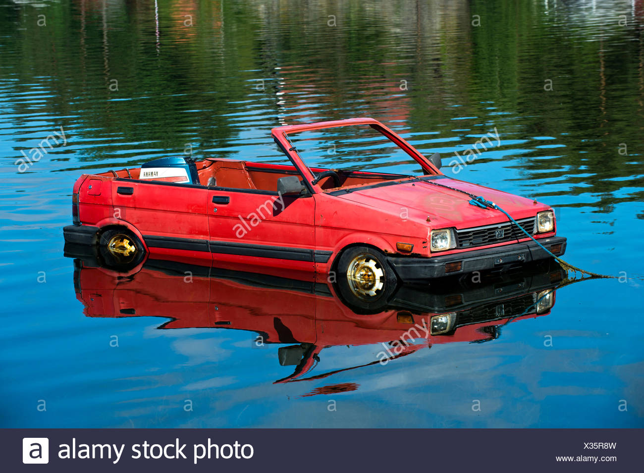Subaru car turned into a boat, floating on a lake, Norway - Stock Image