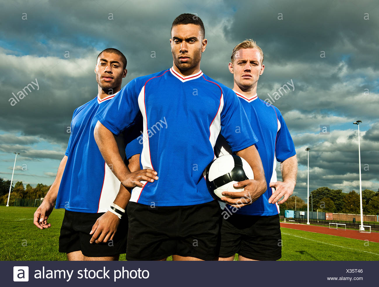 Soccer players on pitch, portrait - Stock Image