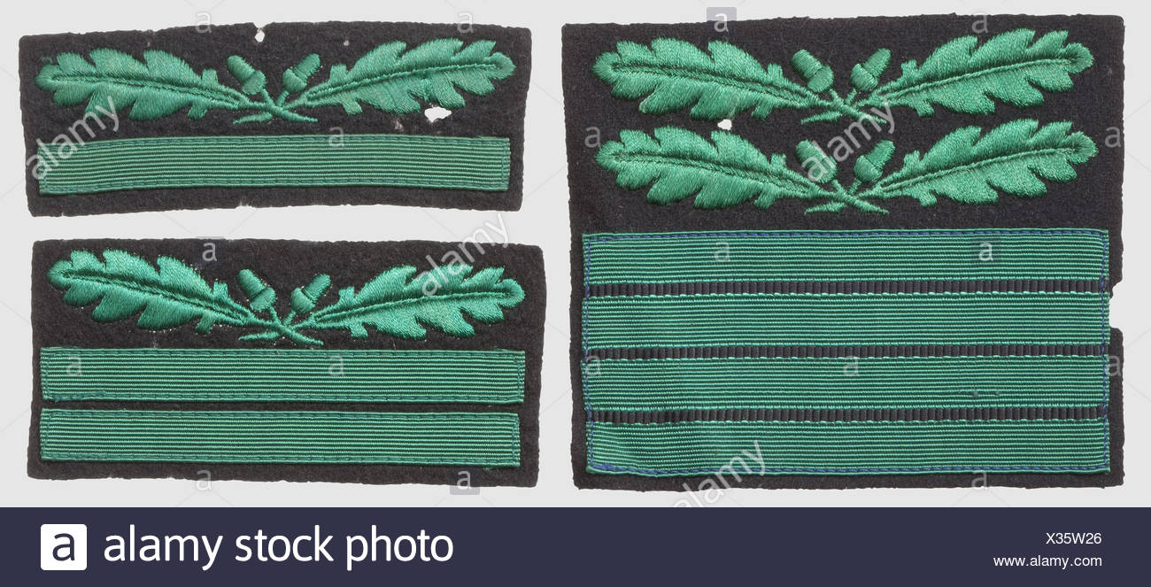 Three rank-badges for the camouflage-uniform, RZM-machine-embroidered issues, green on black cloth for 'SS-Oberführer', 'SS-Obersturmführer' and 'SS-Untersturmführer', historic, historical, 1930s, 1930s, 20th century, secret service, security service, secret services, security services, police, armed service, armed services, NS, National Socialism, Nazism, Third Reich, German Reich, Germany, utensil, piece of equipment, utensils, object, objects, stills, clipping, clippings, cut out, cut-out, cut-outs, fascism, fascistic, National Socialist, Nazi, Nazi period, , Additional-Rights-Clearences-NA - Stock Image