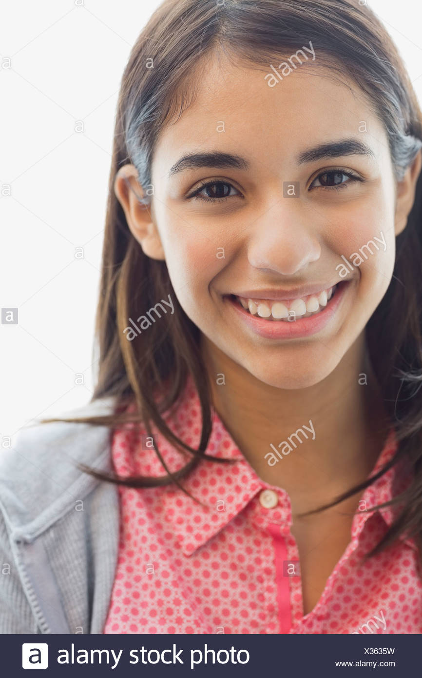 Close-up of smiling teenager - Stock Image