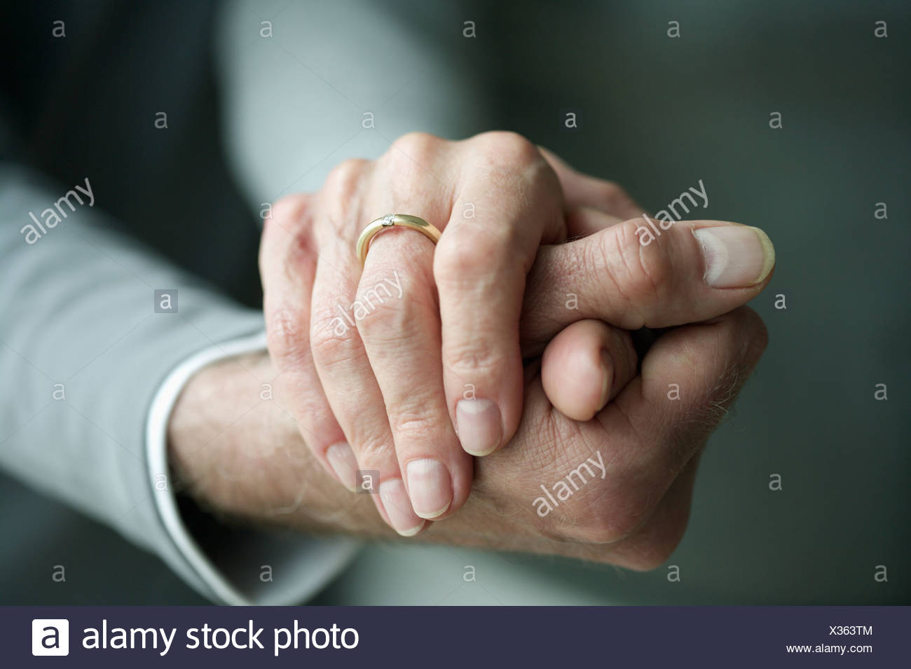Tow hands holding each other - Stock Image