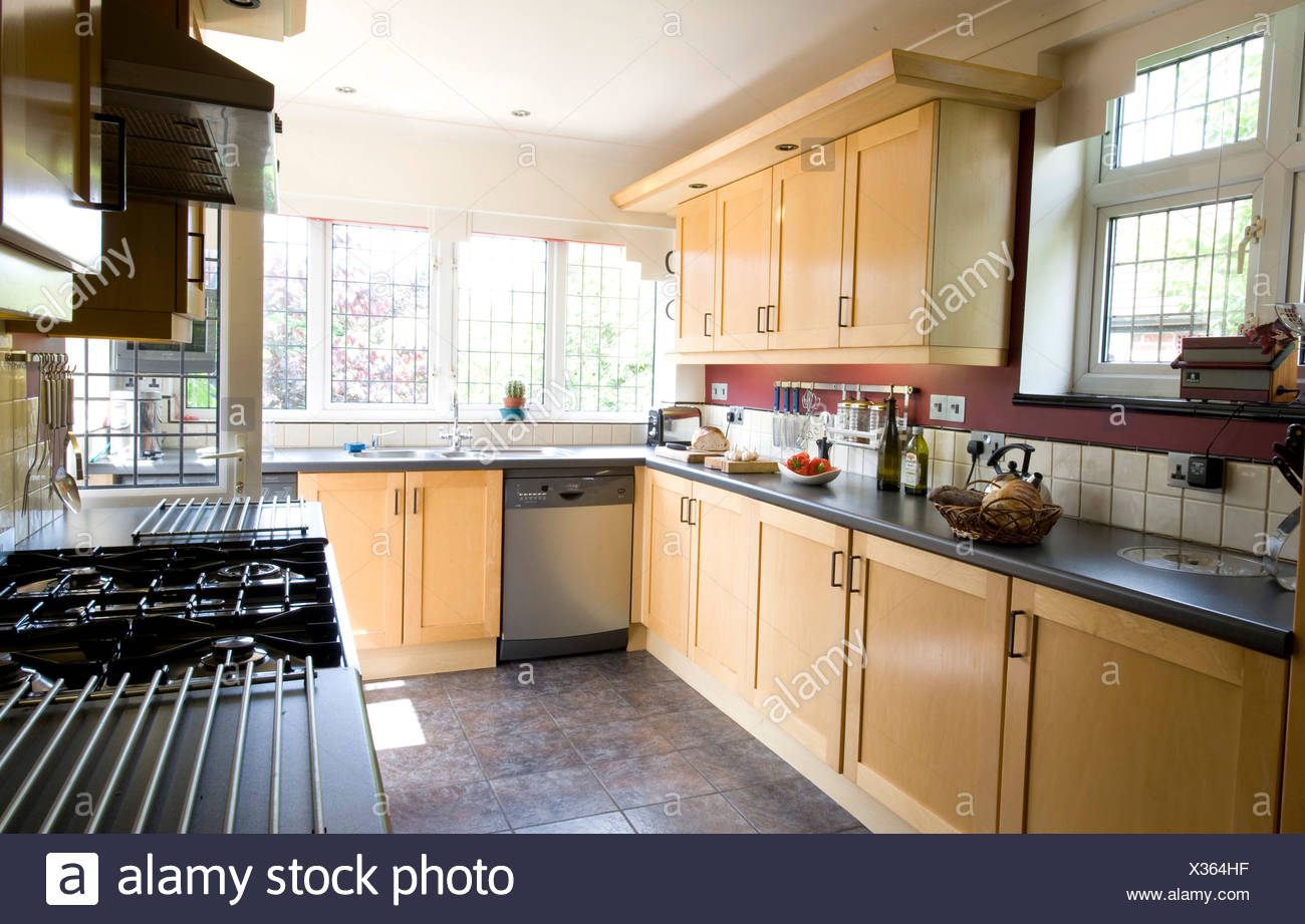Nature's way John Vale and Barbara Gilbert's house in Epping Modern kitchen with beech units Stock Photo