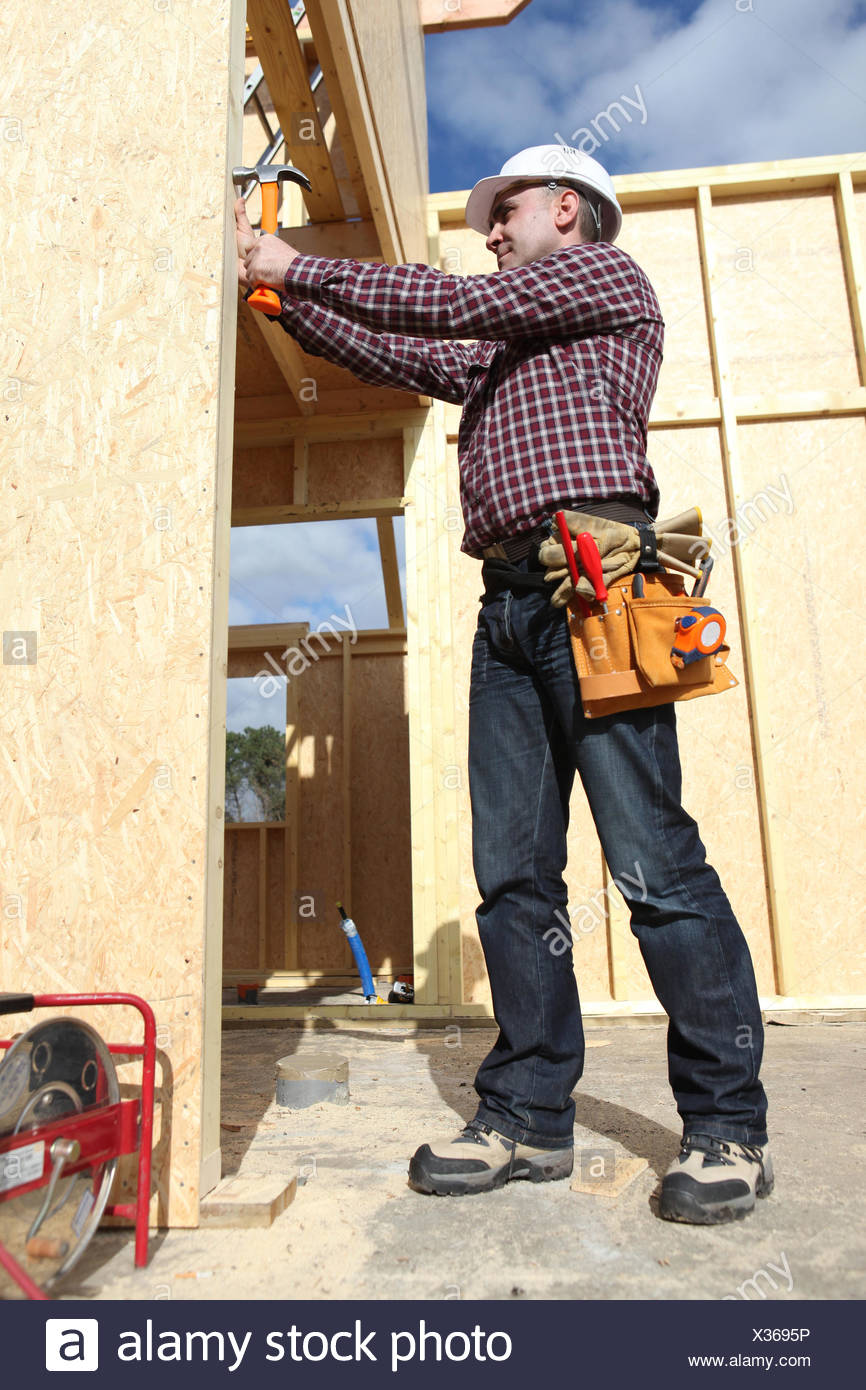 woodworker on a construction site - Stock Image