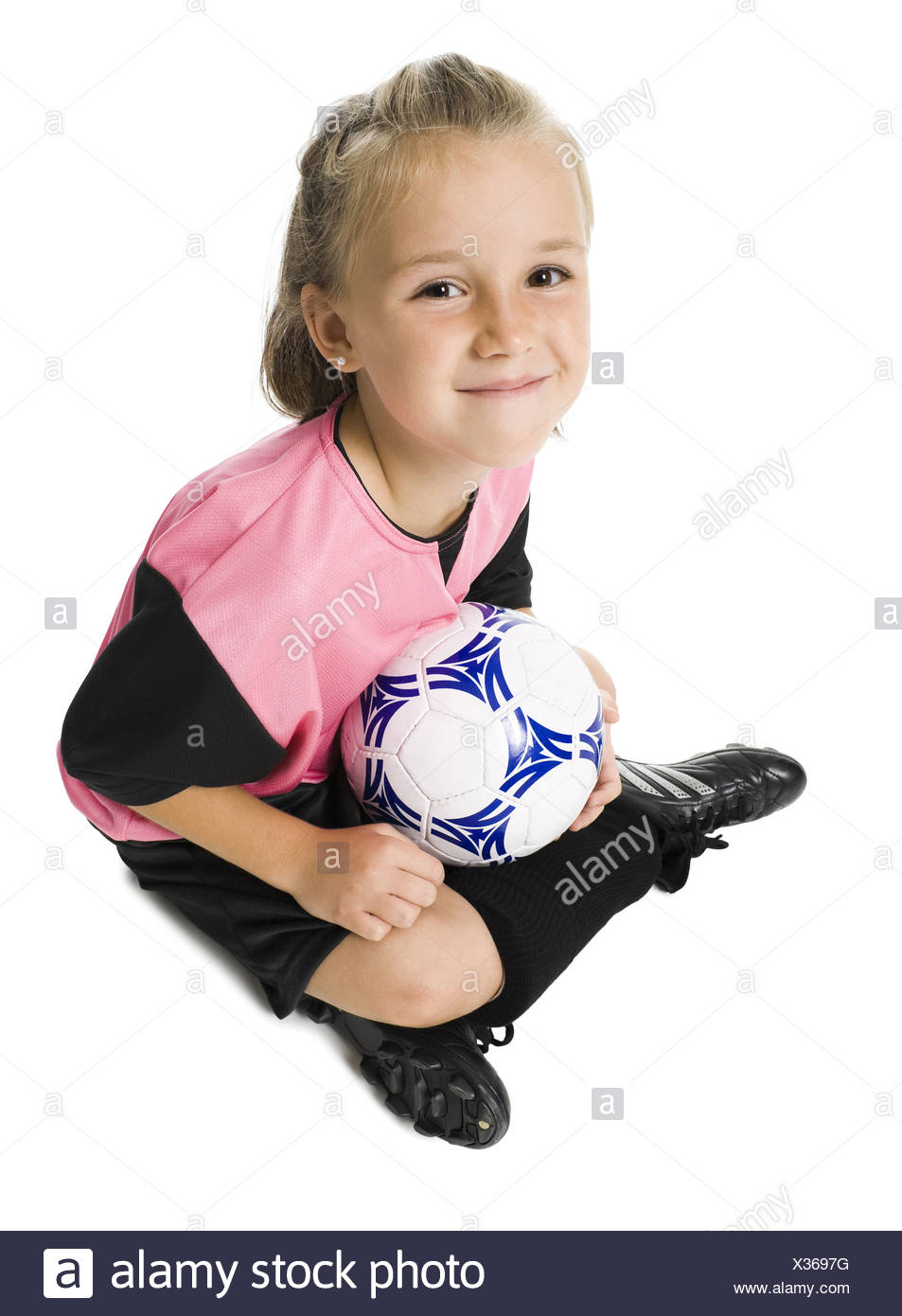 0e2fccfe6 Young girl in a soccer uniform with ball Stock Photo  277348836 - Alamy