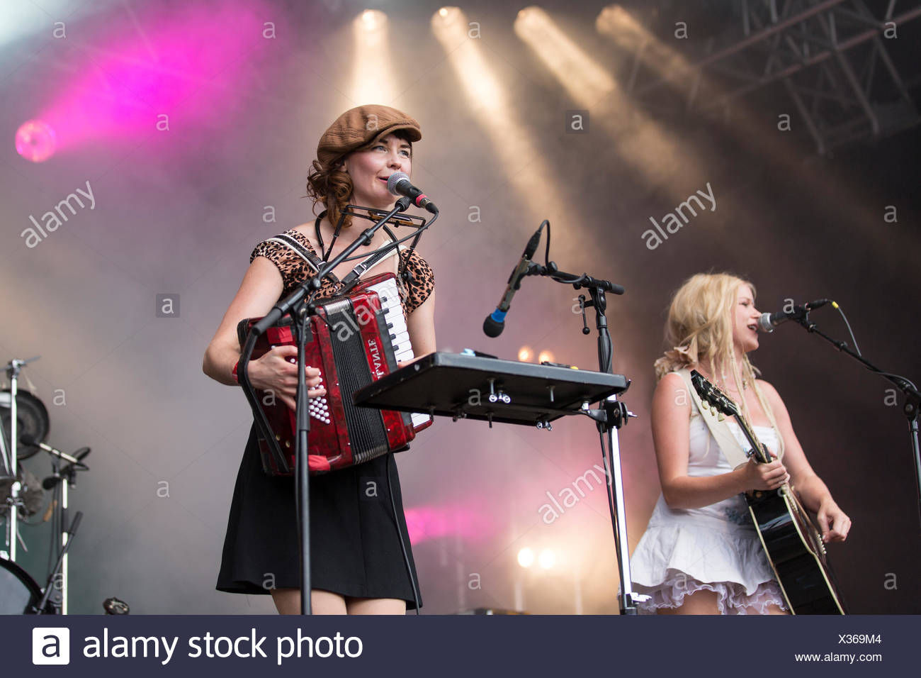 Solveig Heilo with a guitar and Anne Marit Bergheim with an accordion from the Norwegian girl band Katzenjammer performing live - Stock Image