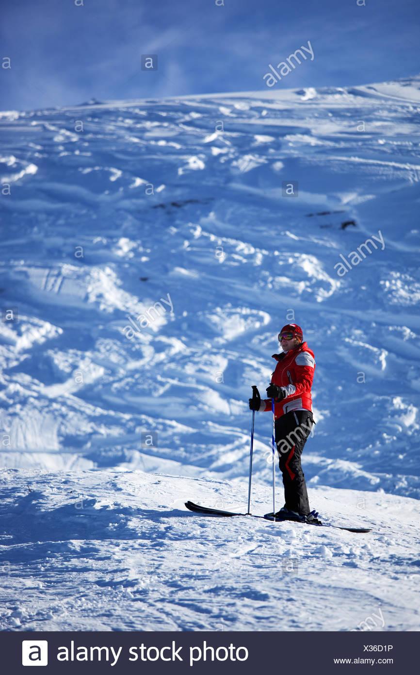 Wuman in red on ski slope Stock Photo