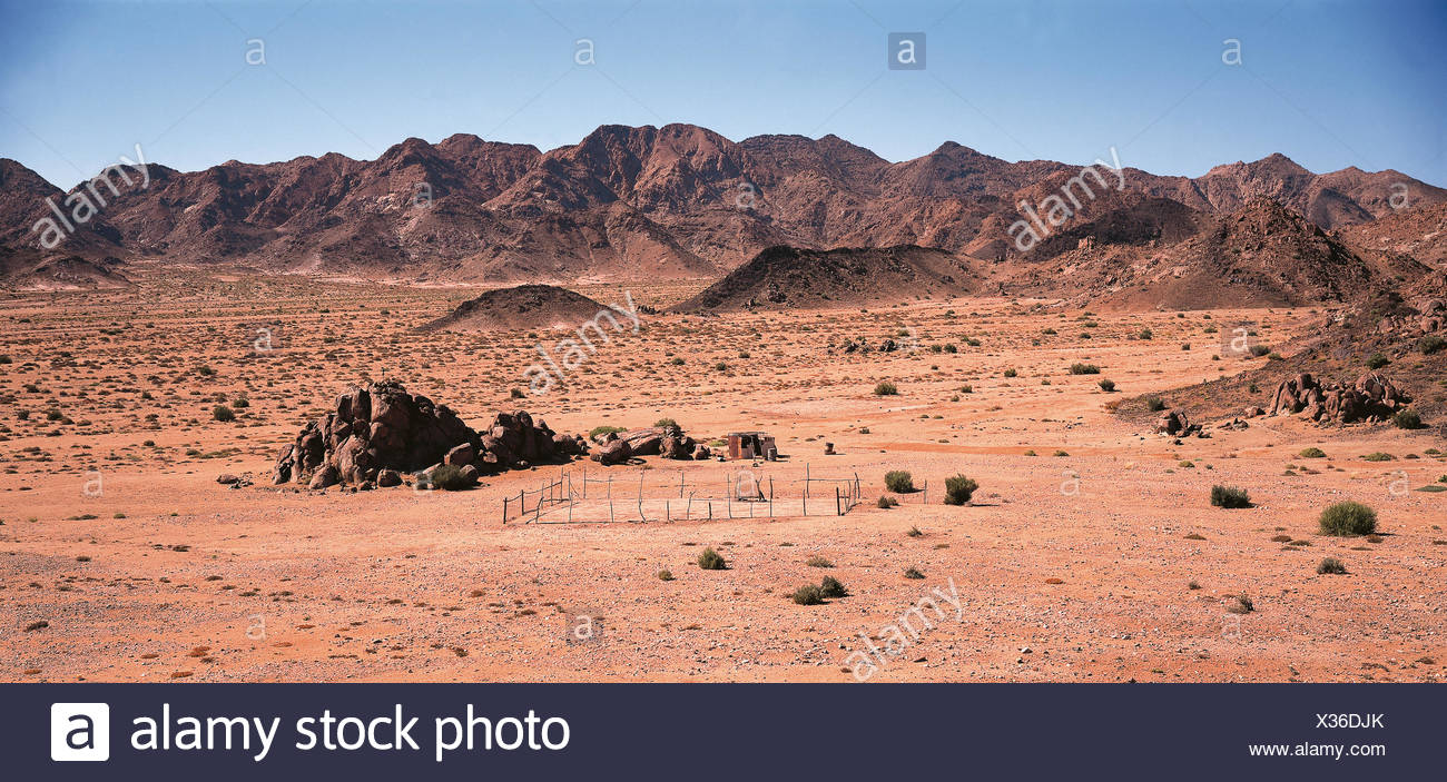 Arid landscape with mountains and small nomadic settlement. Richtersveld National Park, Northern Cape, South Africa, Africa. - Stock Image