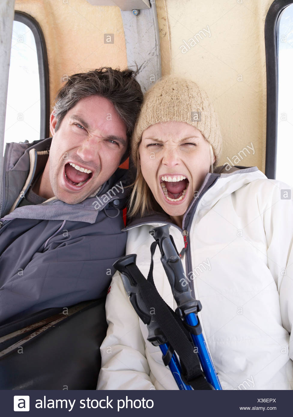 couple screaming at viewer - Stock Image