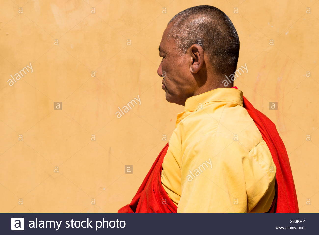 Profile shot of a monk in Bhutan. - Stock Image