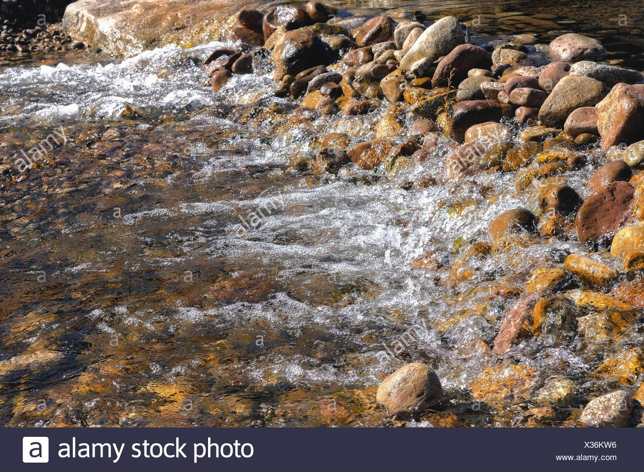 dammed water dam with stones Stock Photo