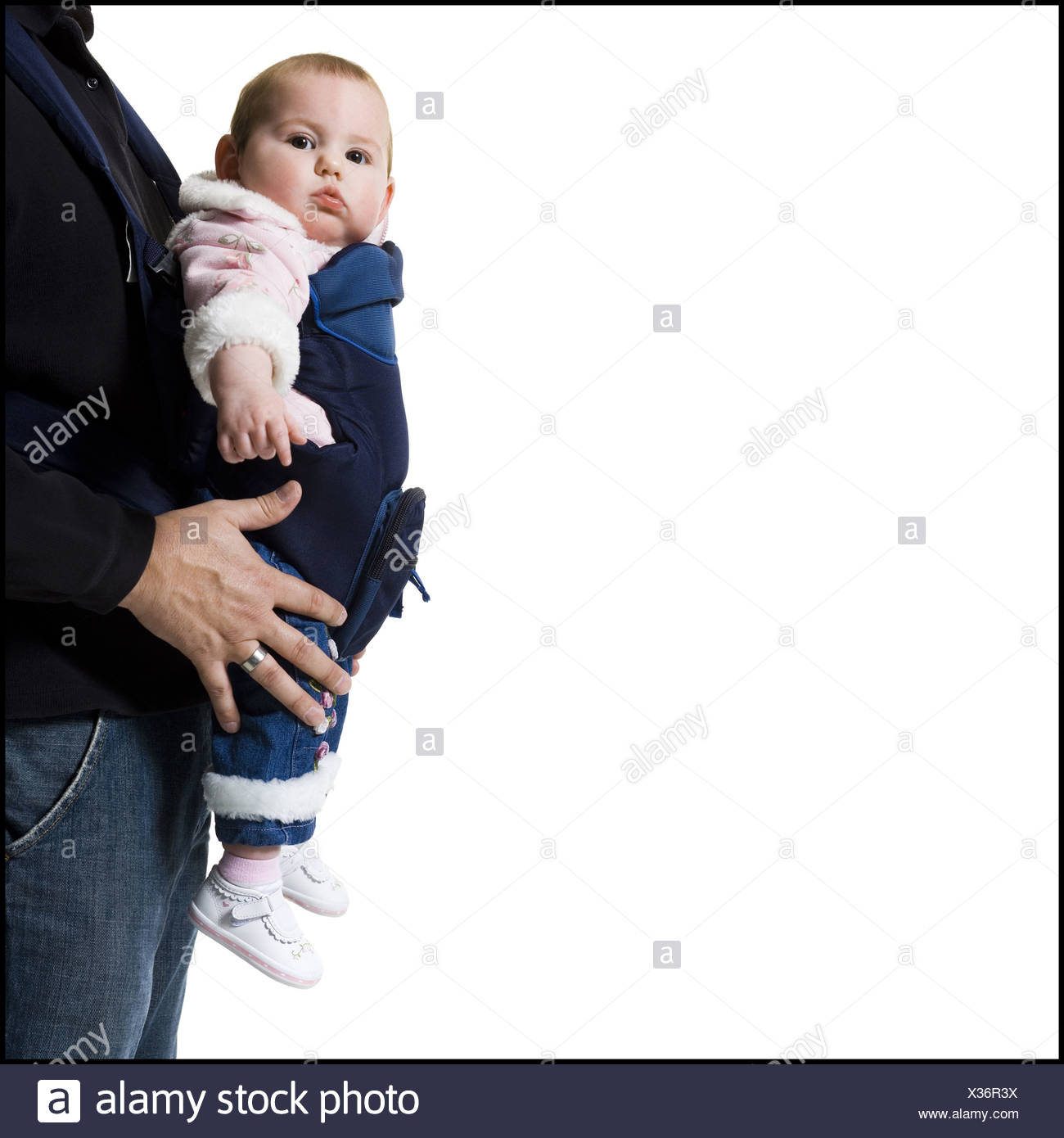 Father with baby in pouch - Stock Image