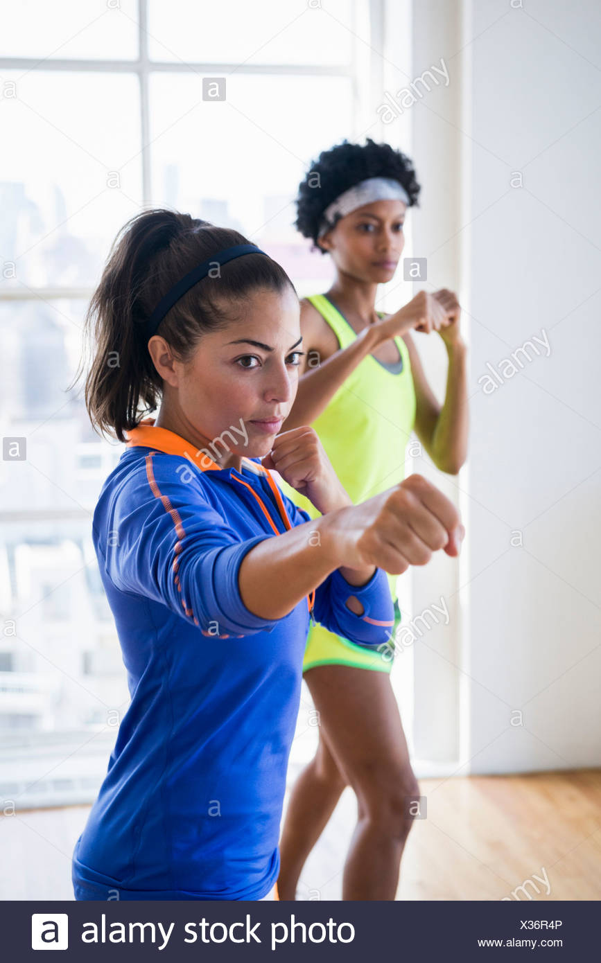 Women punching the air - Stock Image
