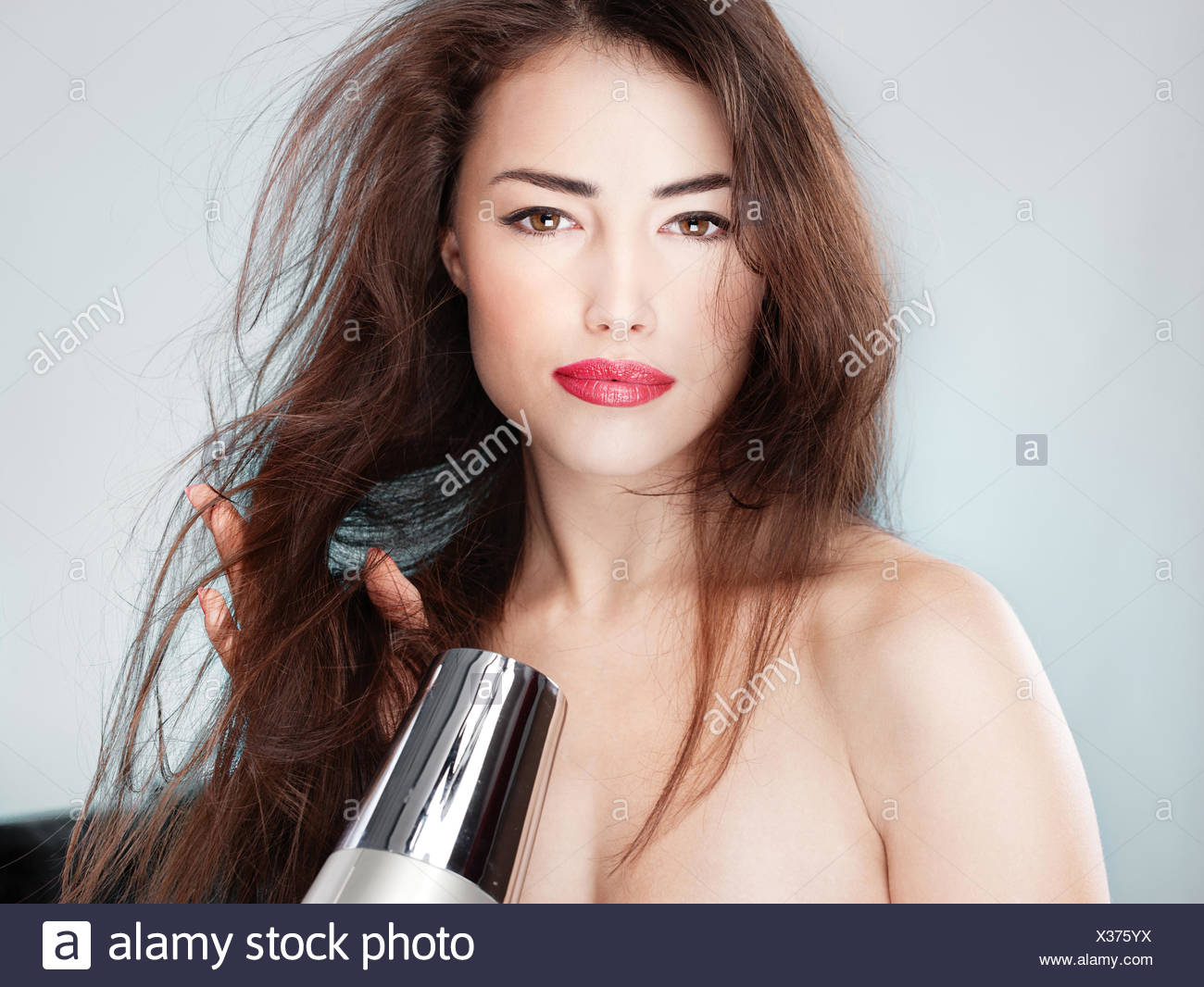 woman dry dried up barren cut designer hair woman hand hands fashion face wash metal wet dapper accosting pretty prettily - Stock Image