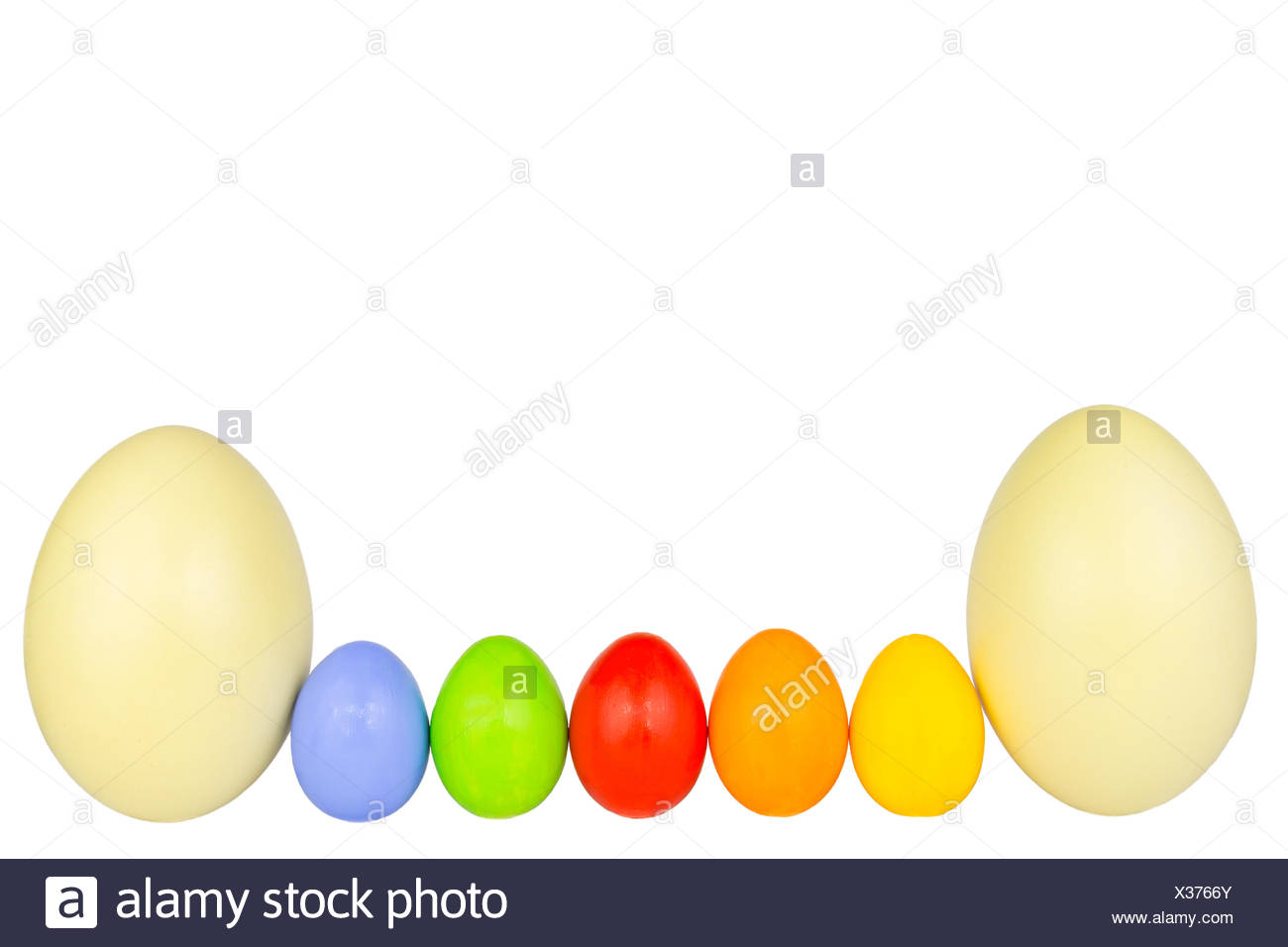 coloured easter eggs in a row 3 - Stock Image